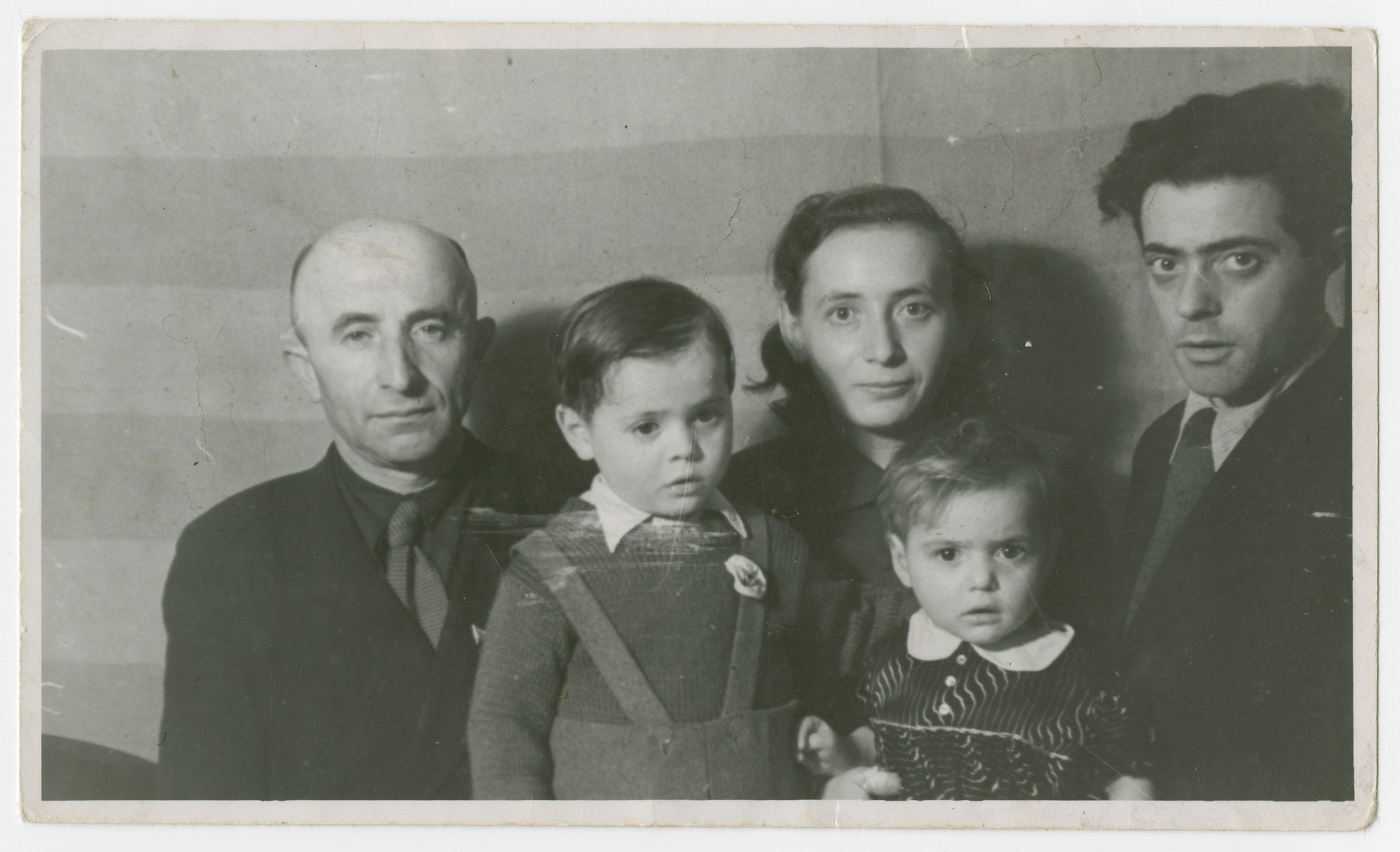 Postwar portrait of the Fridling family in the Schlachtensee displaced persons camp.  From left to right are Abe, Joseph, Gitla, Andzia (Chana) and Abe Fridling.  (The two Abe Fridlings were cousins.)