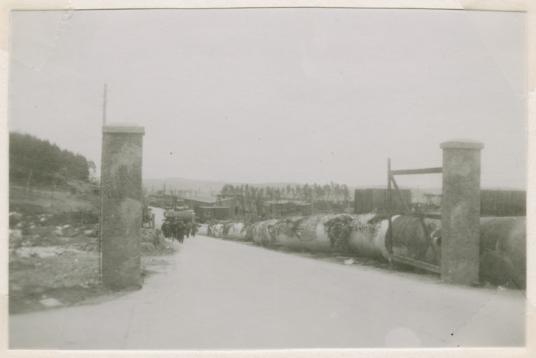 View of the entrance to the V-2 factory and fuel tanks in the Nordhausen concentration camp following liberation.