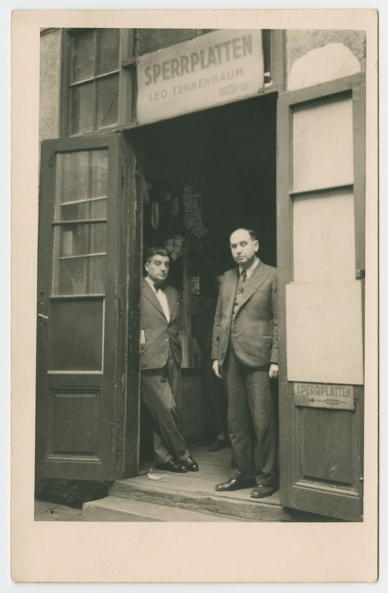 Emil Tennenbaum (later Tanner) and Leo Beller stand in front of the plywood business owned by Leo Tennenbaum (Paul Beller's maternal grandfather).