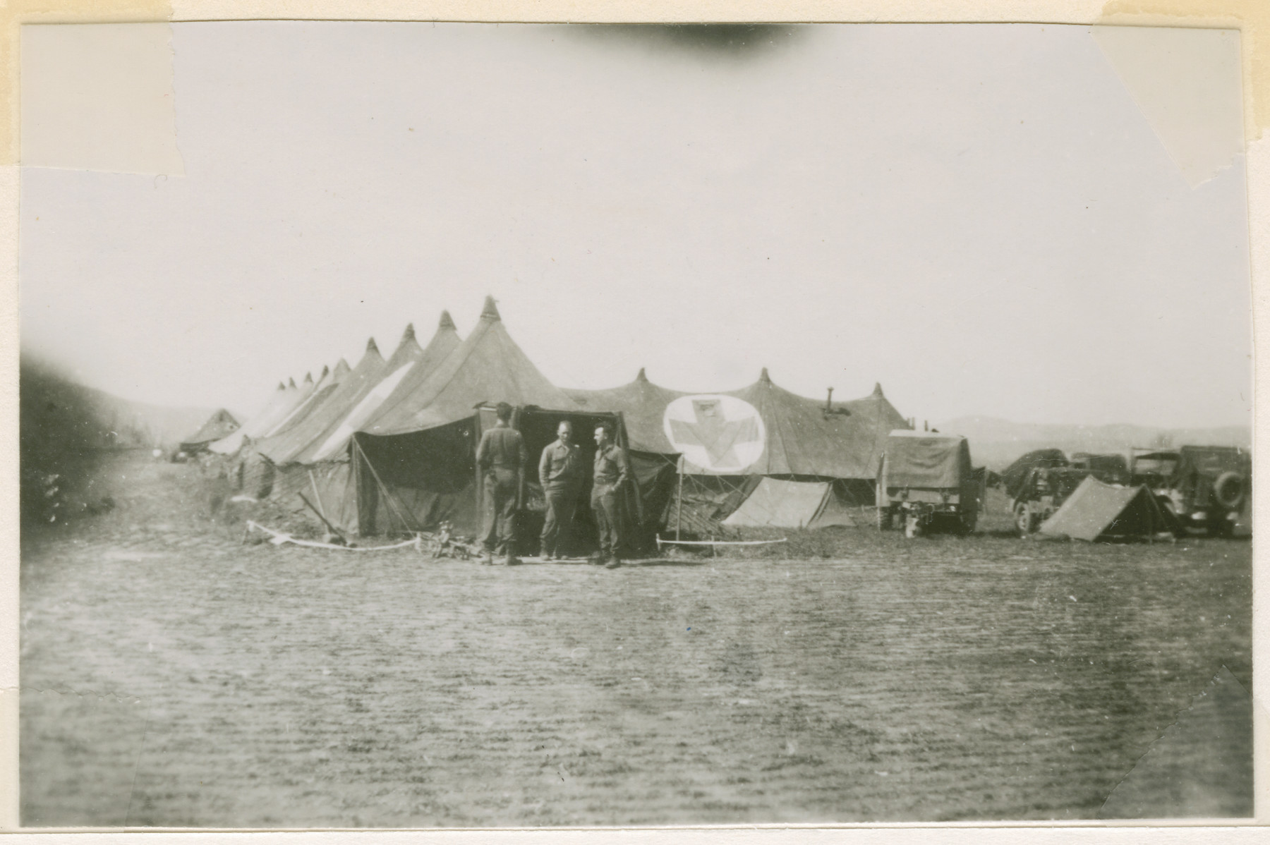American soldiers and medics stand outside the medical team's tents near the Nordhausen concentration camp,
