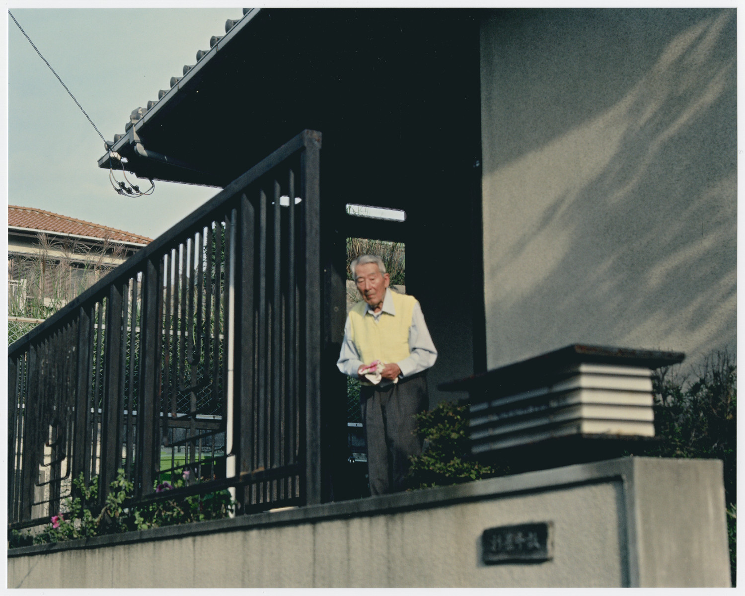 Chiune Sugihara stands on the balcony of his home in Kama Kura, Japan.