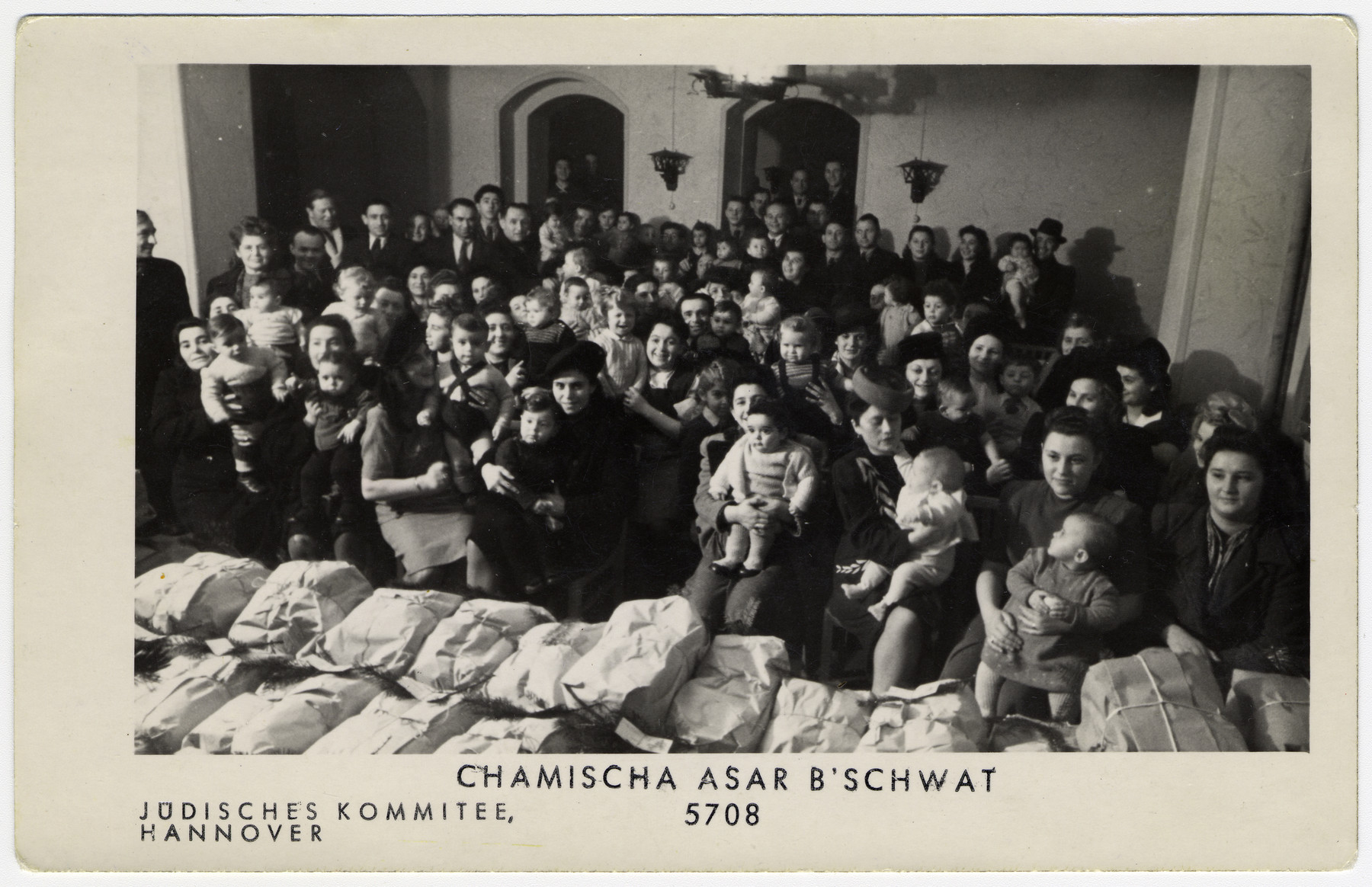 Jewish men, women and children celebrate Tu B'Shvat in the Hanover displaced persons camp.
