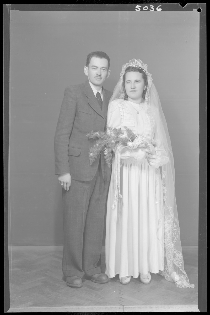 Studio wedding portrait of Jeno Wioer and his bride.
