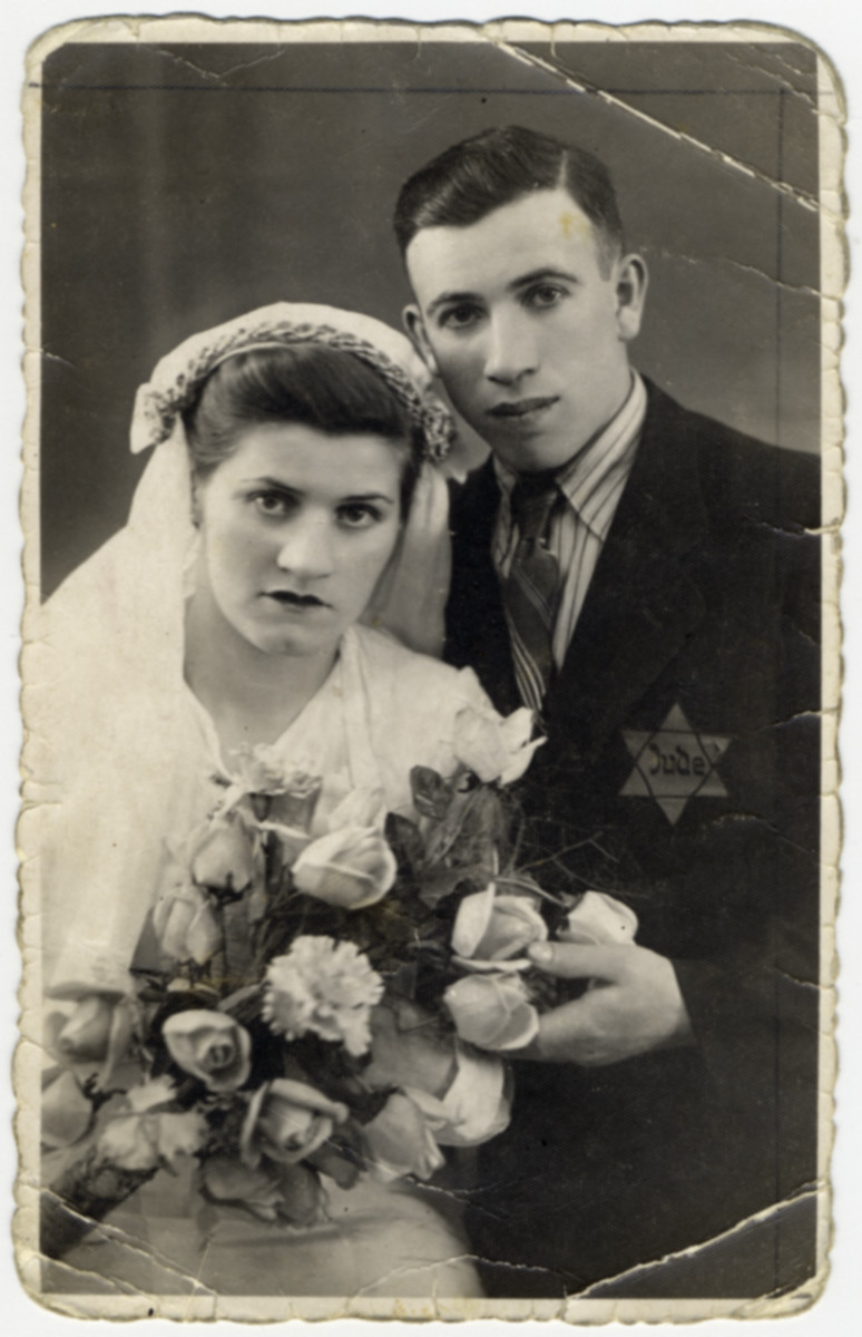 "A wedding portrait of a couple from Lazy, wearing a yellow star.   The original caption reads ""Sent as a remembrance to my brother and sister"".  The bride is one of the sisters of Esther Rosengarten either Gitl/Gita orKraindel."