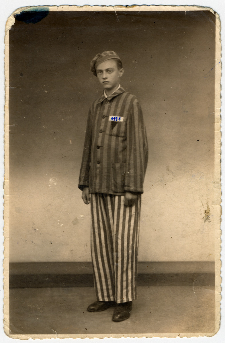 "A young survivor of Buchenwald poses in his camp uniform several months after liberation; his camp number has been drawn onto the photo.  The original caption reads: ""To my dear friend from Buchenwald.  As proof of my friendship, Wolf Waynfeld."""