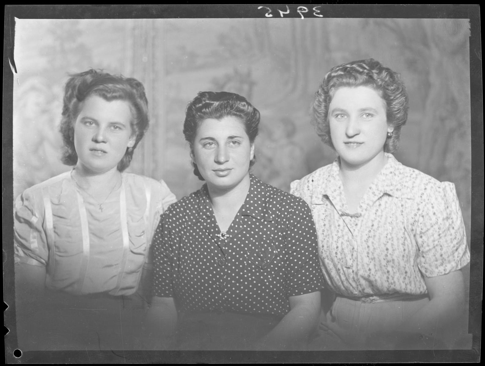 Studio portrait of Roszi Wizenfelder and two other women.