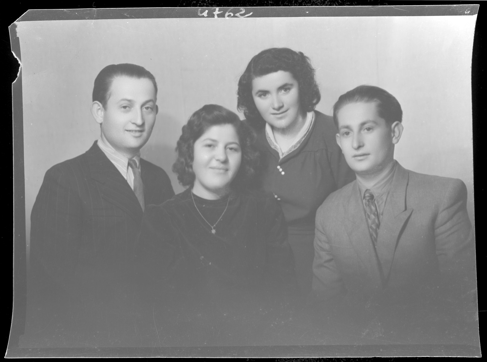Group studio portrait of Dezne Zonder and three other young people.