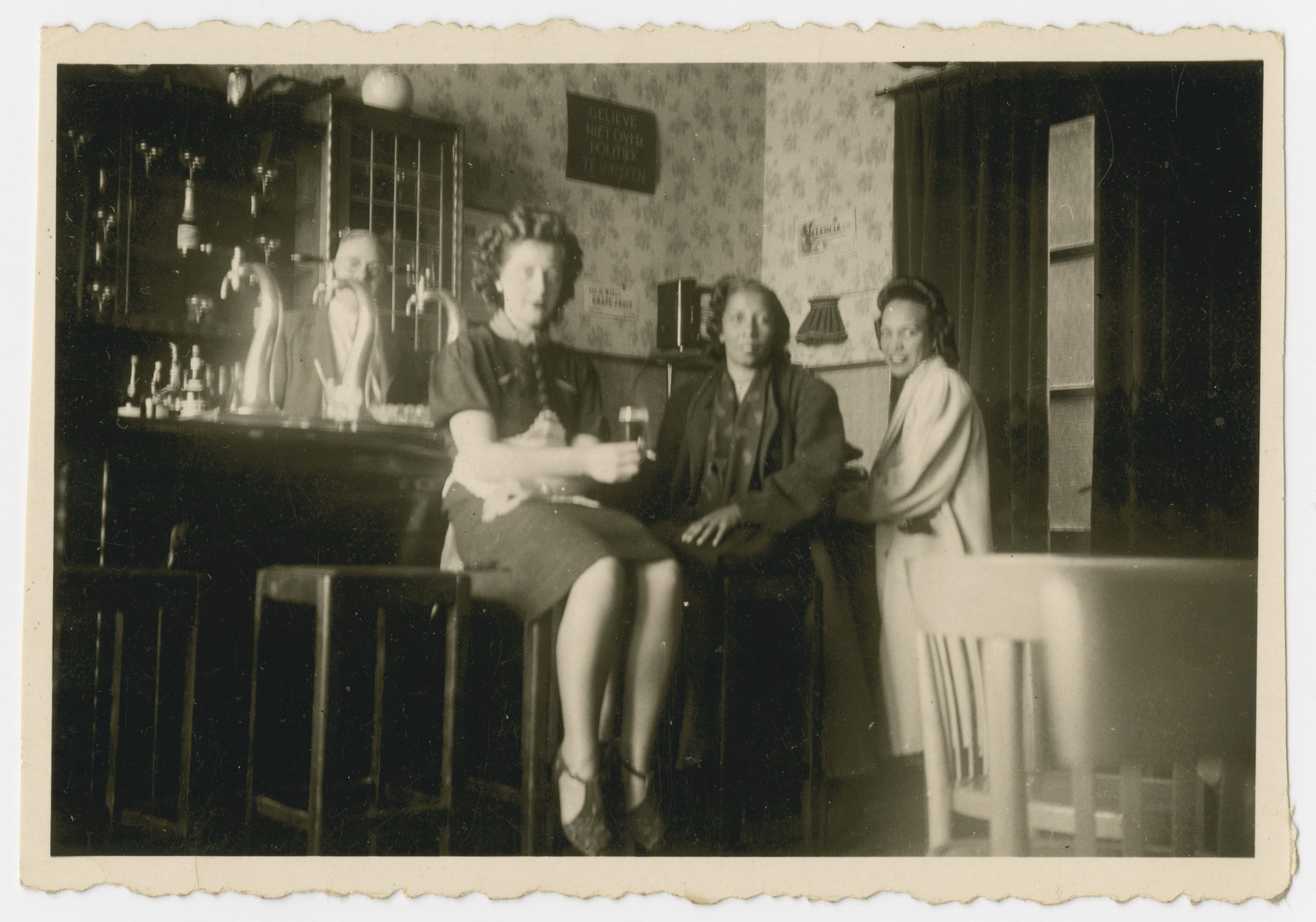 Ida Johnson and two friends gather by a bar in The Hague.