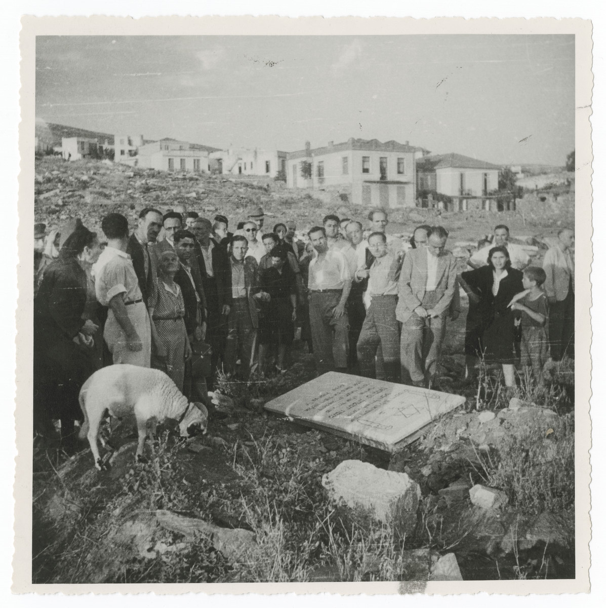 Greek survivors gather for a memorial service at the site of the desecrated Jewish cemetery in Salonika.