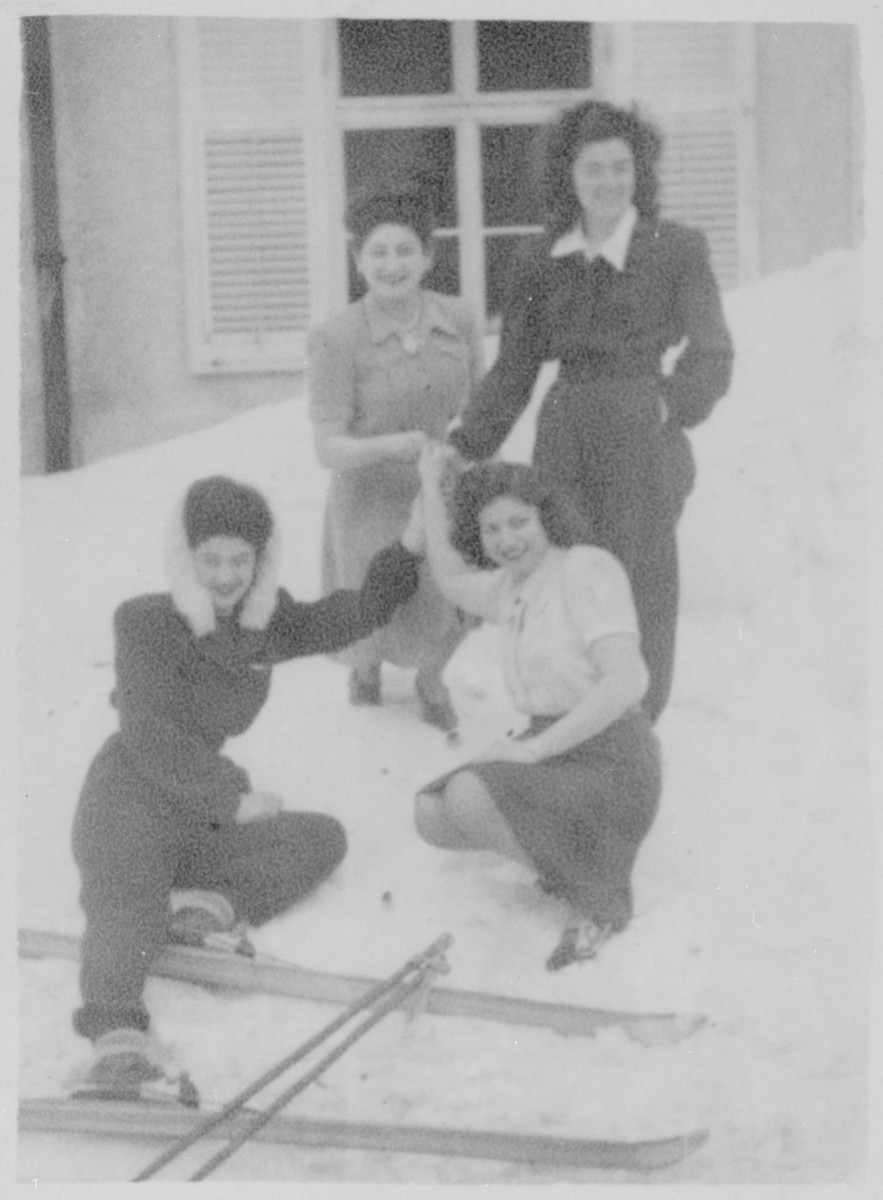 Four women pose outside in the snow in the Feldafing displaced persons camp.  From left to right, from top are Magda and Vicki Herskovits.  Front row: Katya and Gizelle Hersh.