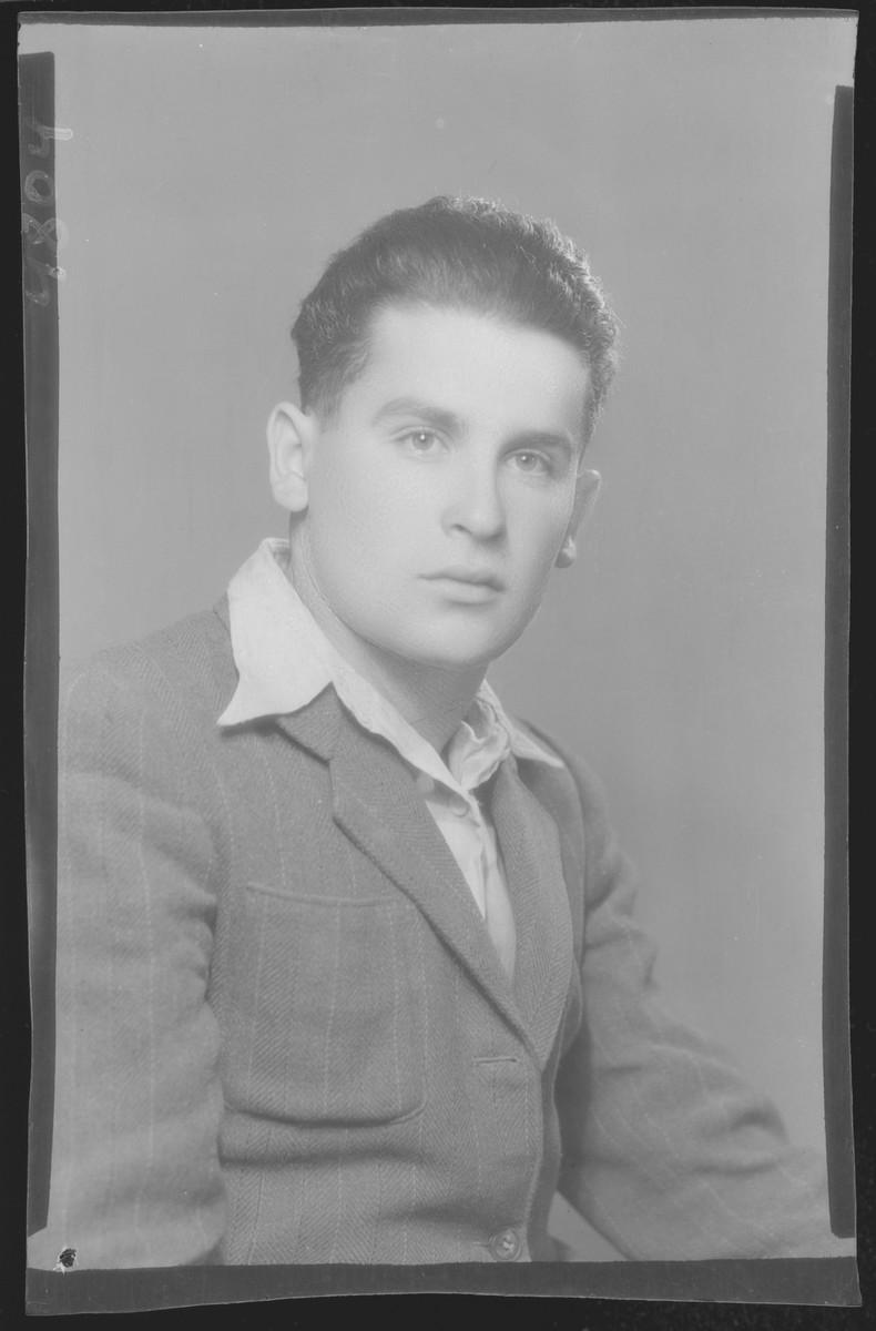 Studio portrait of Rafael Lovinger.
