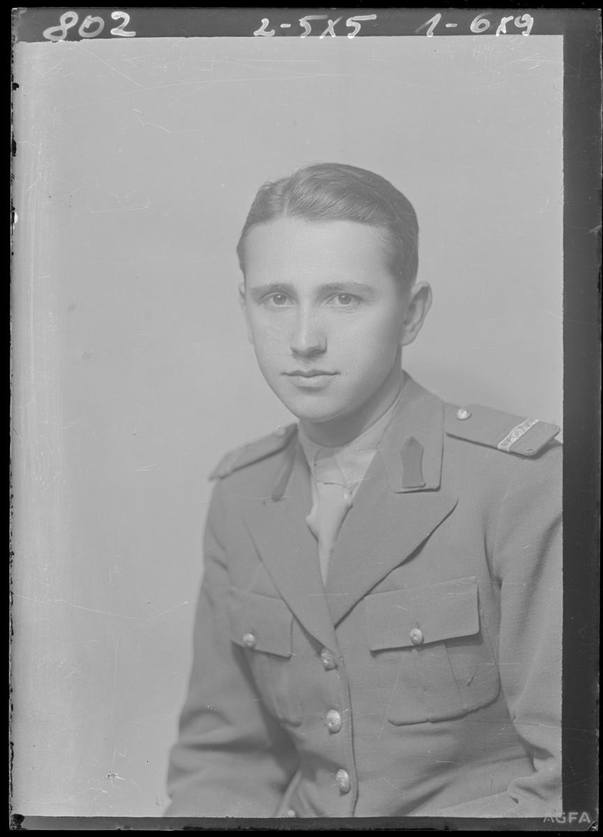 Studio portrait of Miklas Lowi, in military uniform.