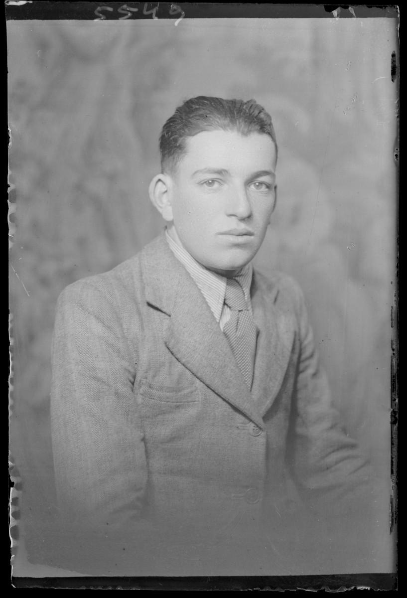 Studio portrait of Adolf Lebi.