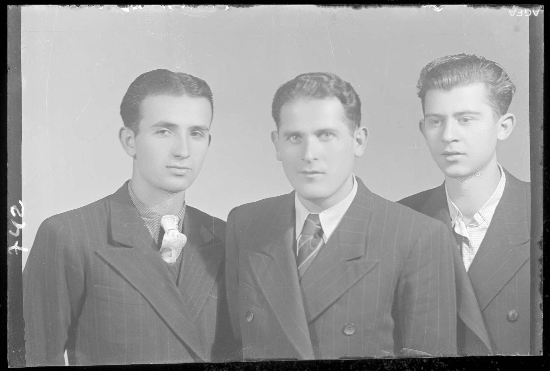 Studio portrait of Ferene Perl and two other young men.
