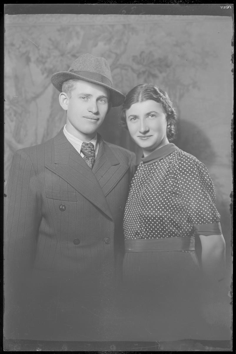 Studio portrait of Marton Moskovits and his wife.