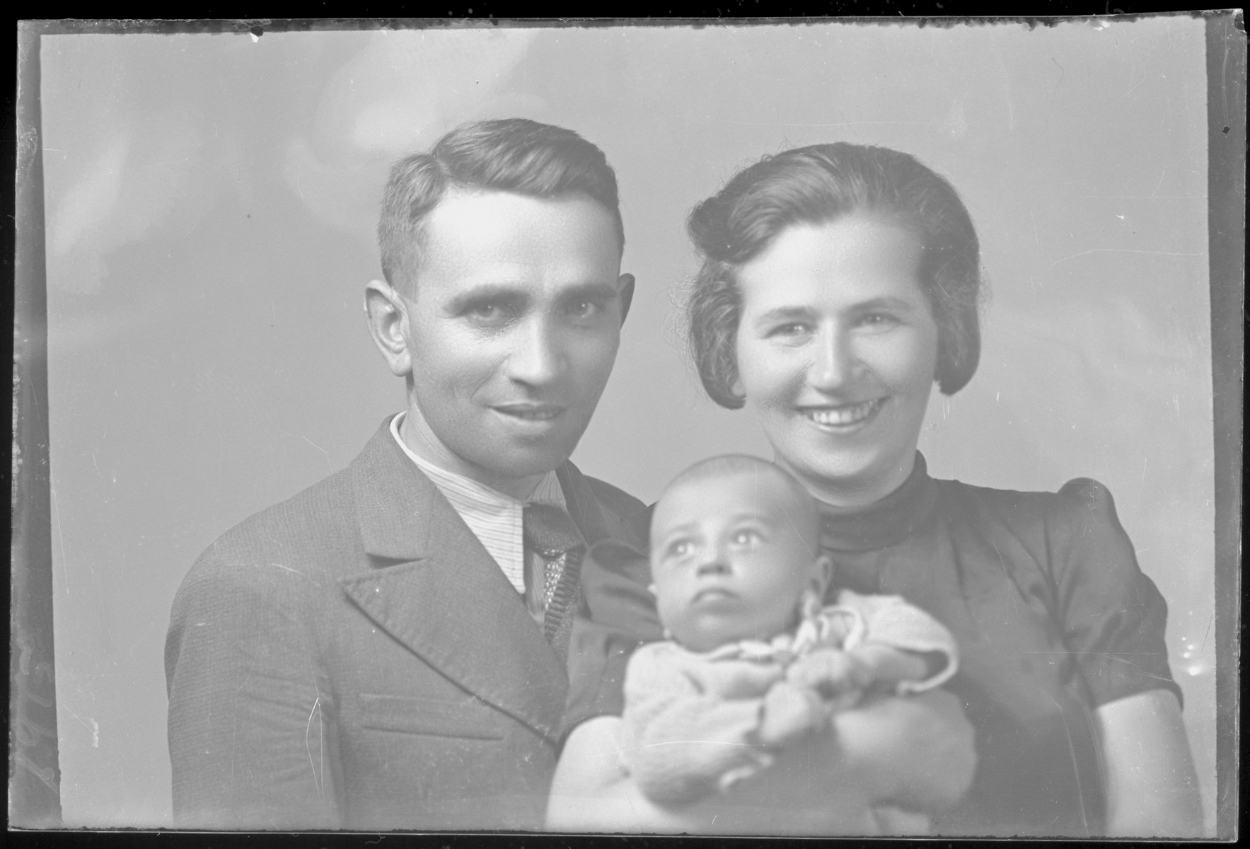 Studio portrait of Samuel Klein, his wife and child.