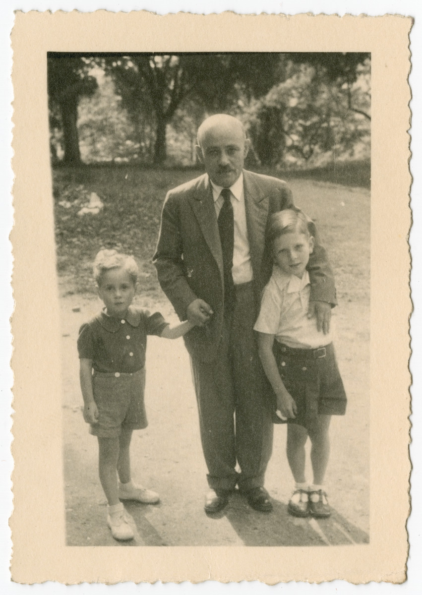 Boris Wolosoff poses with two young boys in Chateau-le-Masgelier.