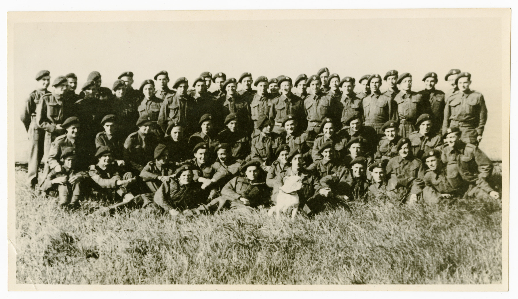 Group portrait of the X Troop -- a unit of German speaking British soliders, officially the 3rd Troop of the Tenth Inter-Allied IA Commamdos.