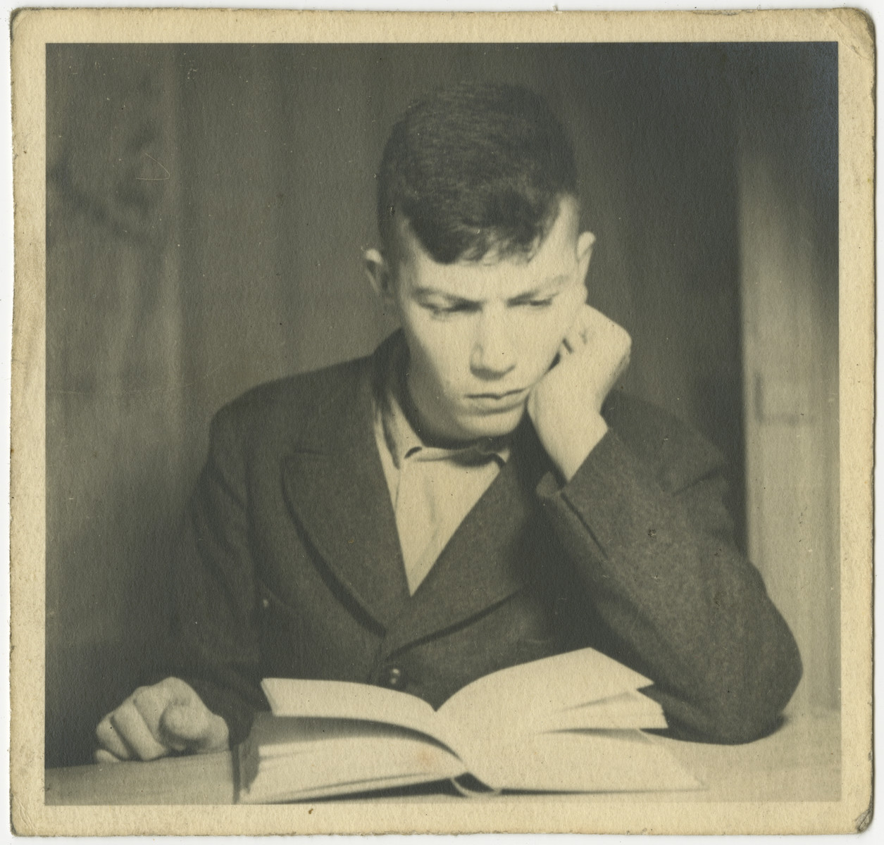 Carl Gans (now Gershon Kaddar) reads a book.