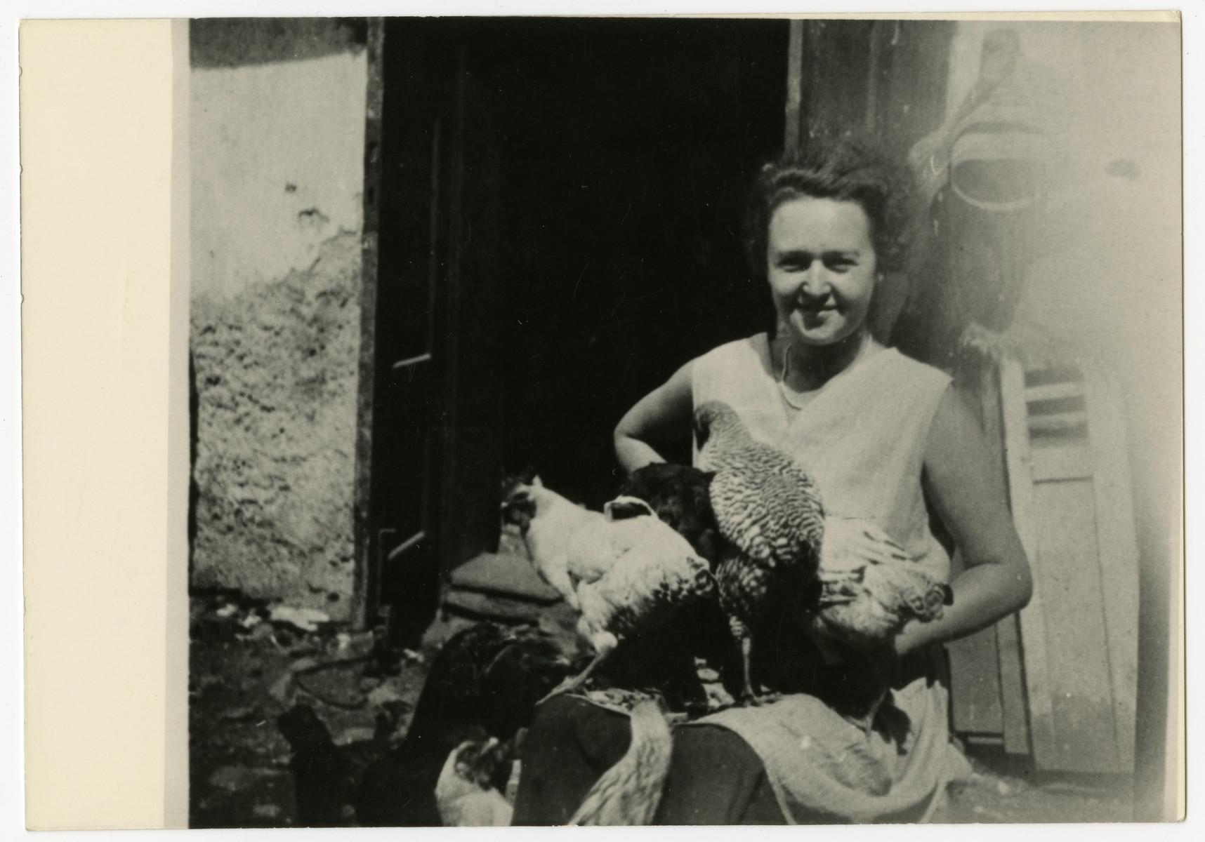 Piroska Vjecsner feeds chickens outside her home in Kremnica.
