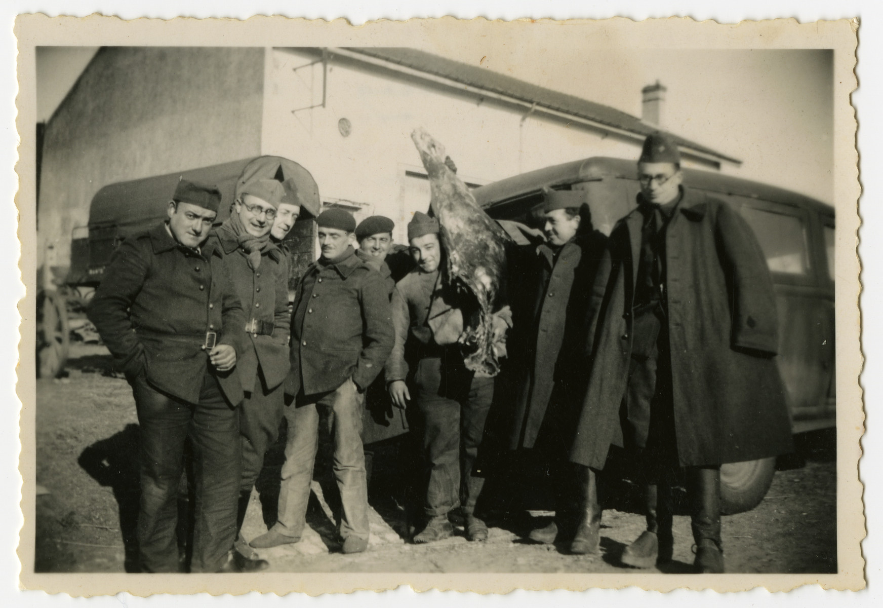 Group portrait of French soldiers.  Included are Alexander Markon, a Jewish immigrant from Lithuania.  One of the soldiers is holding an animal carcass