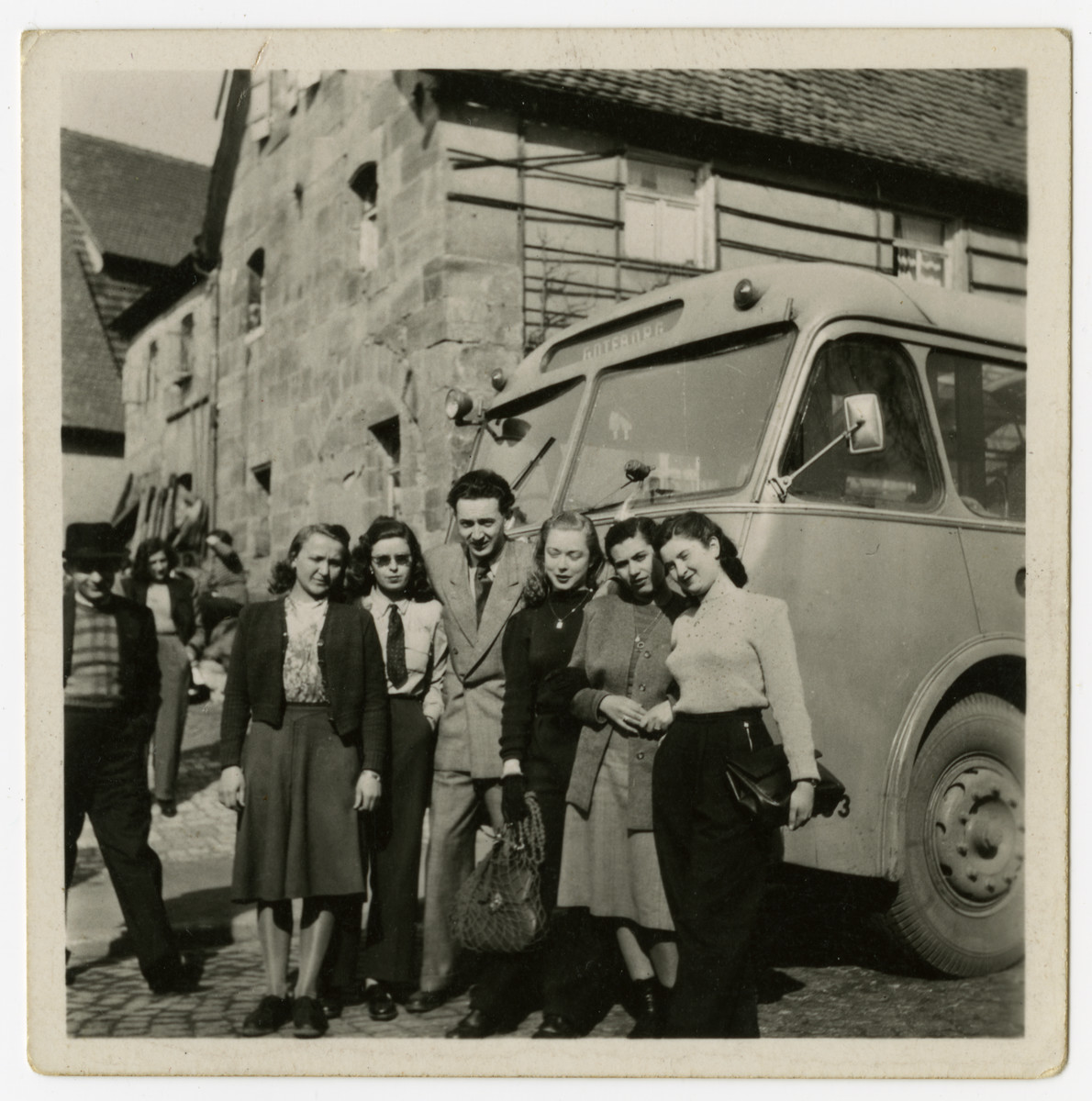 Jewish survivors from Czechoslovakia pose in front of their bus en route to Goteborg, Sweden.    From Goteborg they boarded a ship to the United States.  Paul Vjecsner pictured in the center.