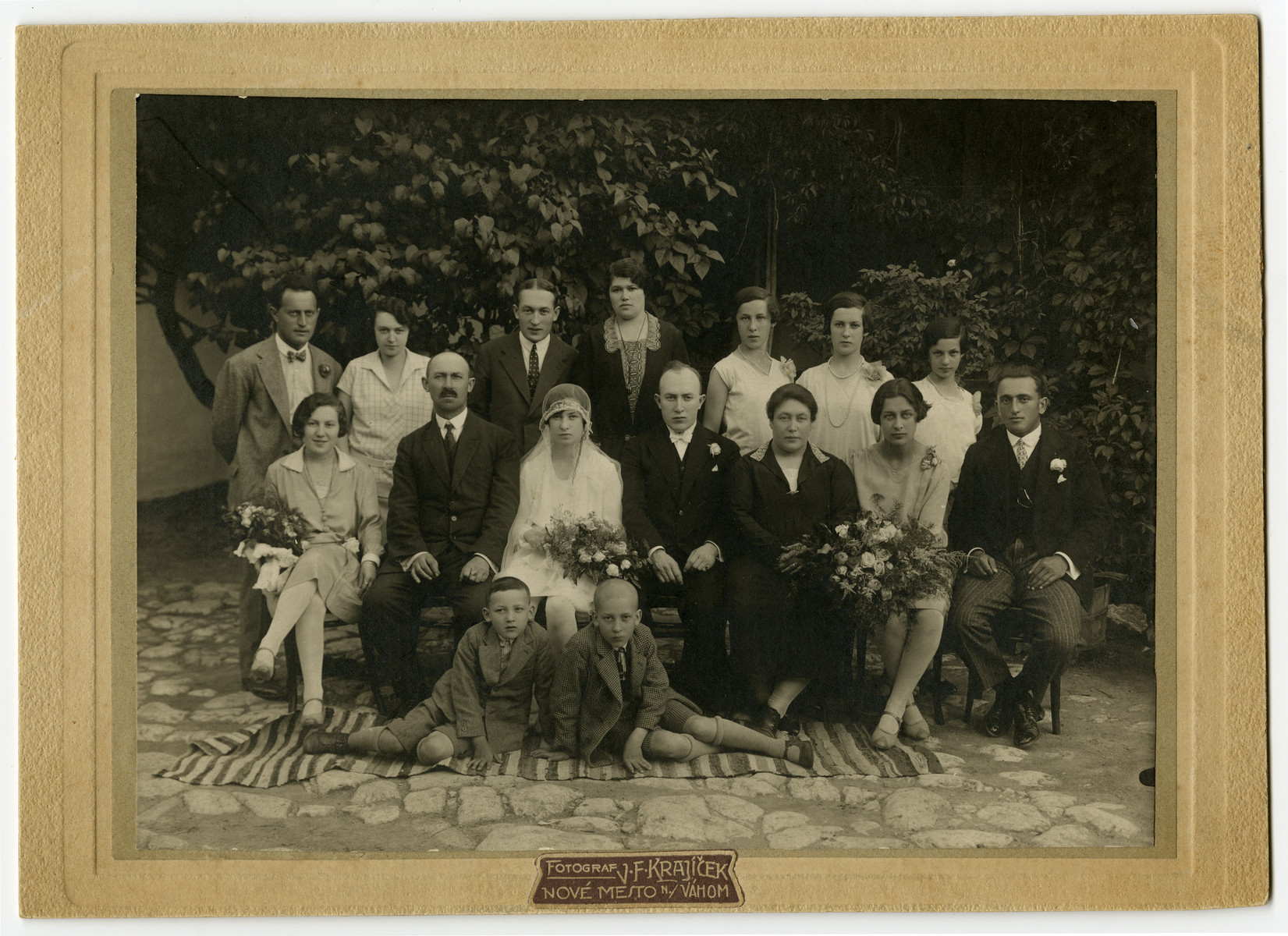 Family portrait of a Jewish wedding in Nove Mesto.  The bride and groom were both relatives of Jakob Vjecsner.  They immigrated to the United States.  Jakob and Piroska Vjecsner are pictured in the second row, second and third from the left.