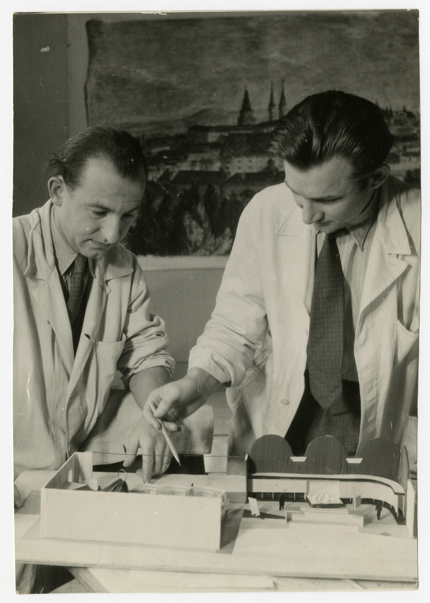 Two commercial artists build a model [probably in postwar Czechoslovakia].