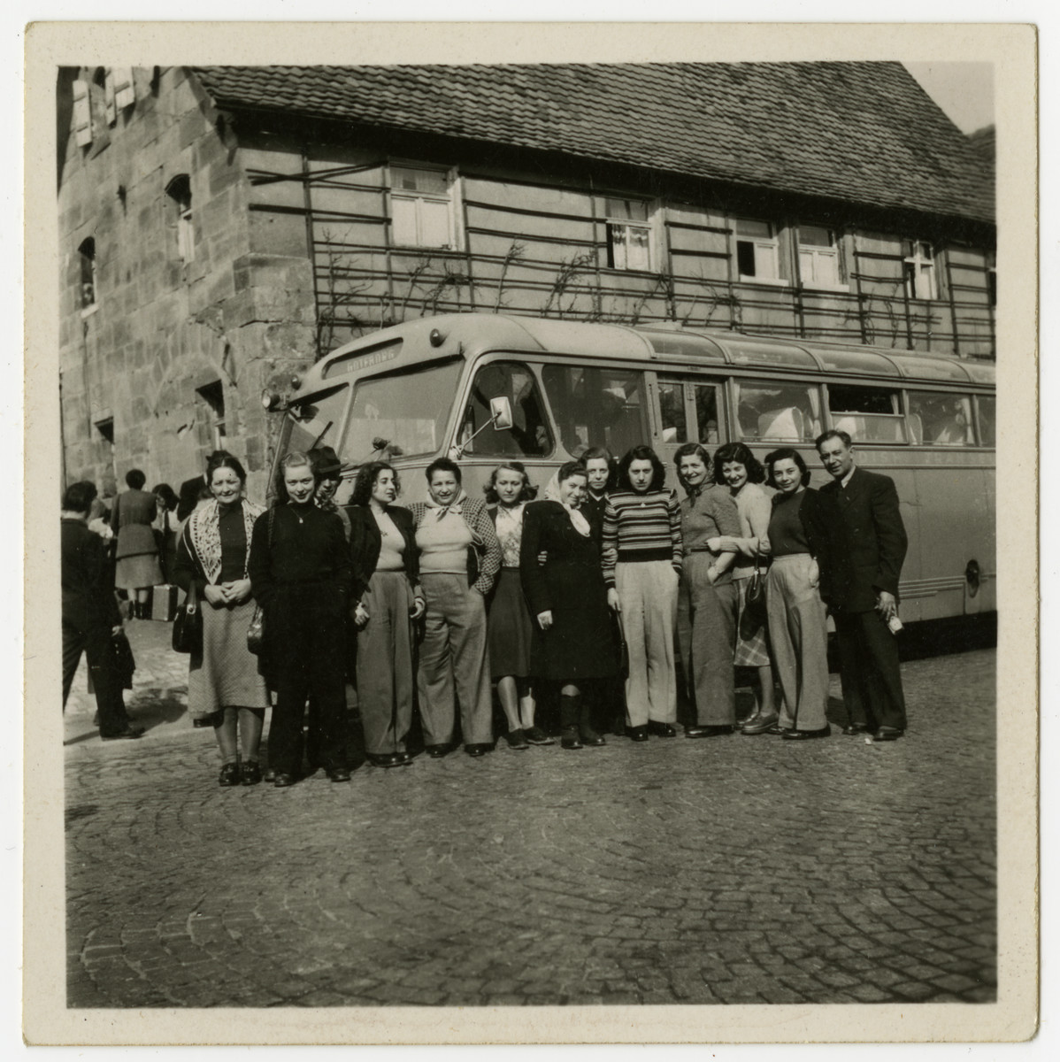 Jewish survivors from Czechoslovakia pose in front of their bus en route to Goteborg, Sweden.    From Goteborg they boarded a ship to the United States.