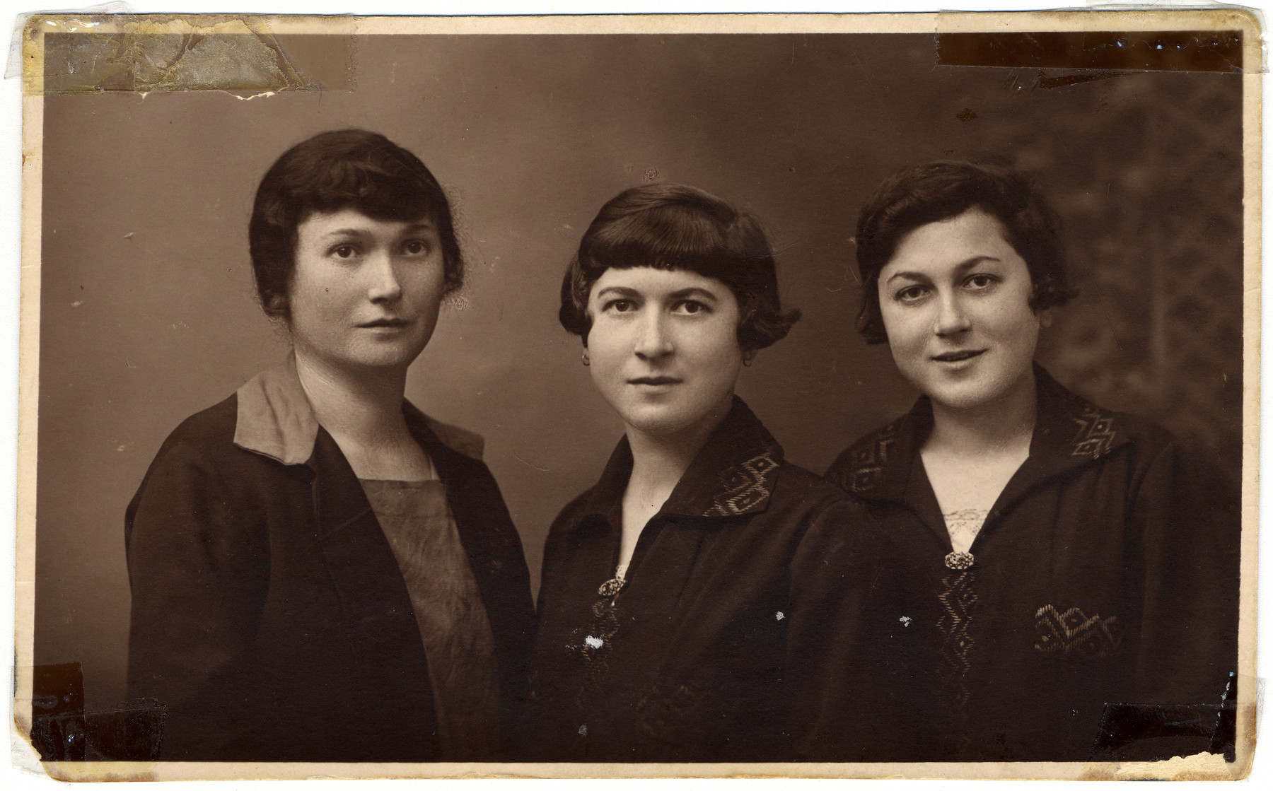 Studio portrait of three of the Rosenthal sisters including Rywka (the donor's mother).