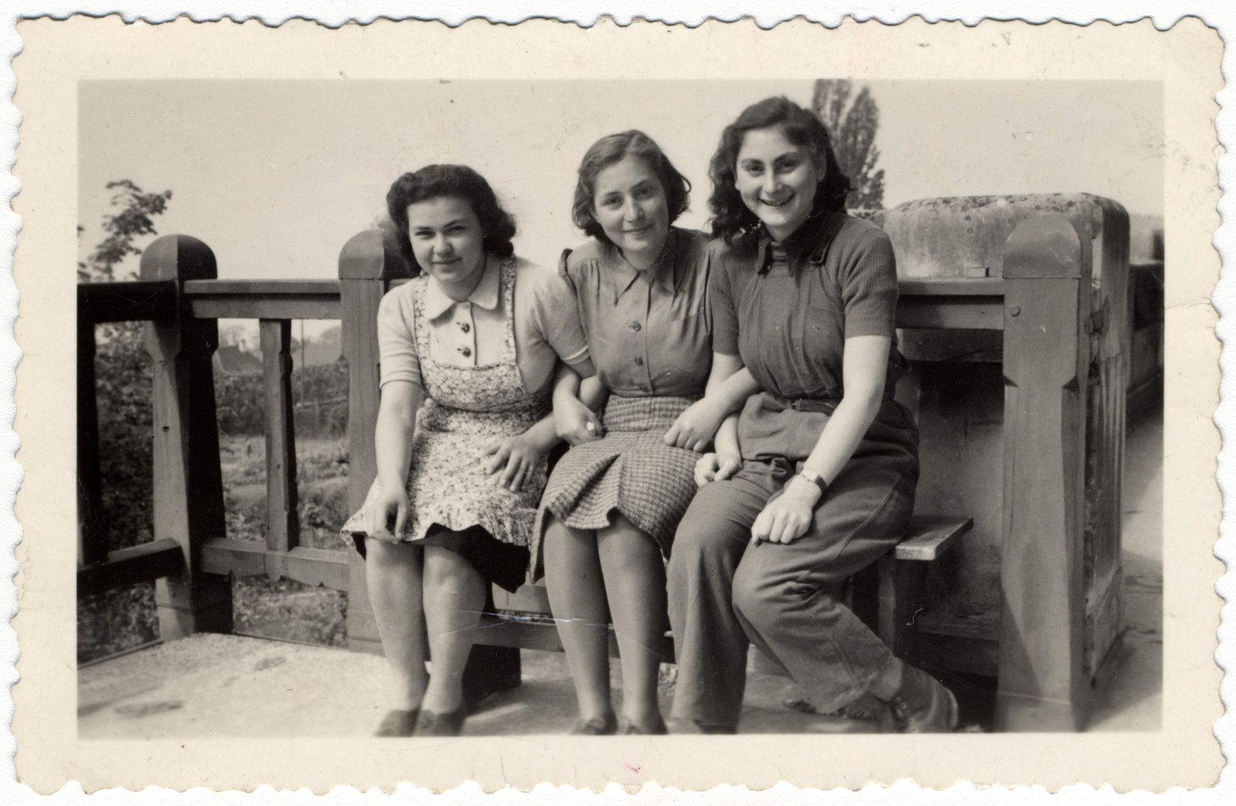 Three teenage girls sit on the terrace of the Home General Bernheim in Zuen, Belgium.   From left are Else Rosenblatt, Lotte Nussbaum and Ruth Klonower. All came to La Hille in 1941.