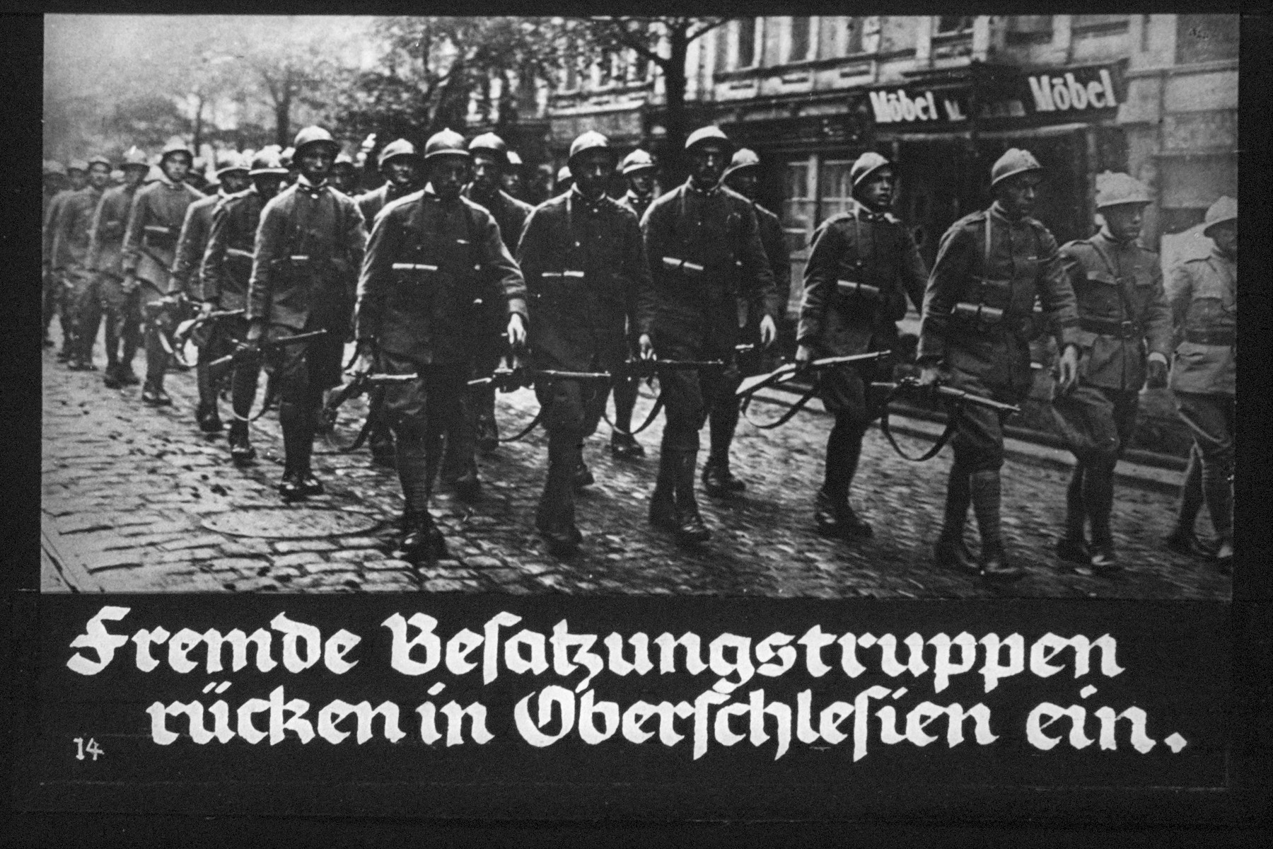 "15th Nazi propaganda slide from Hitler Youth educational material titled ""Border Land Upper Silesia.""  Fremde Besatzungstruppen rücken in Oberschlesien ein. // Foreign occupation troops move into Upper Silesia."