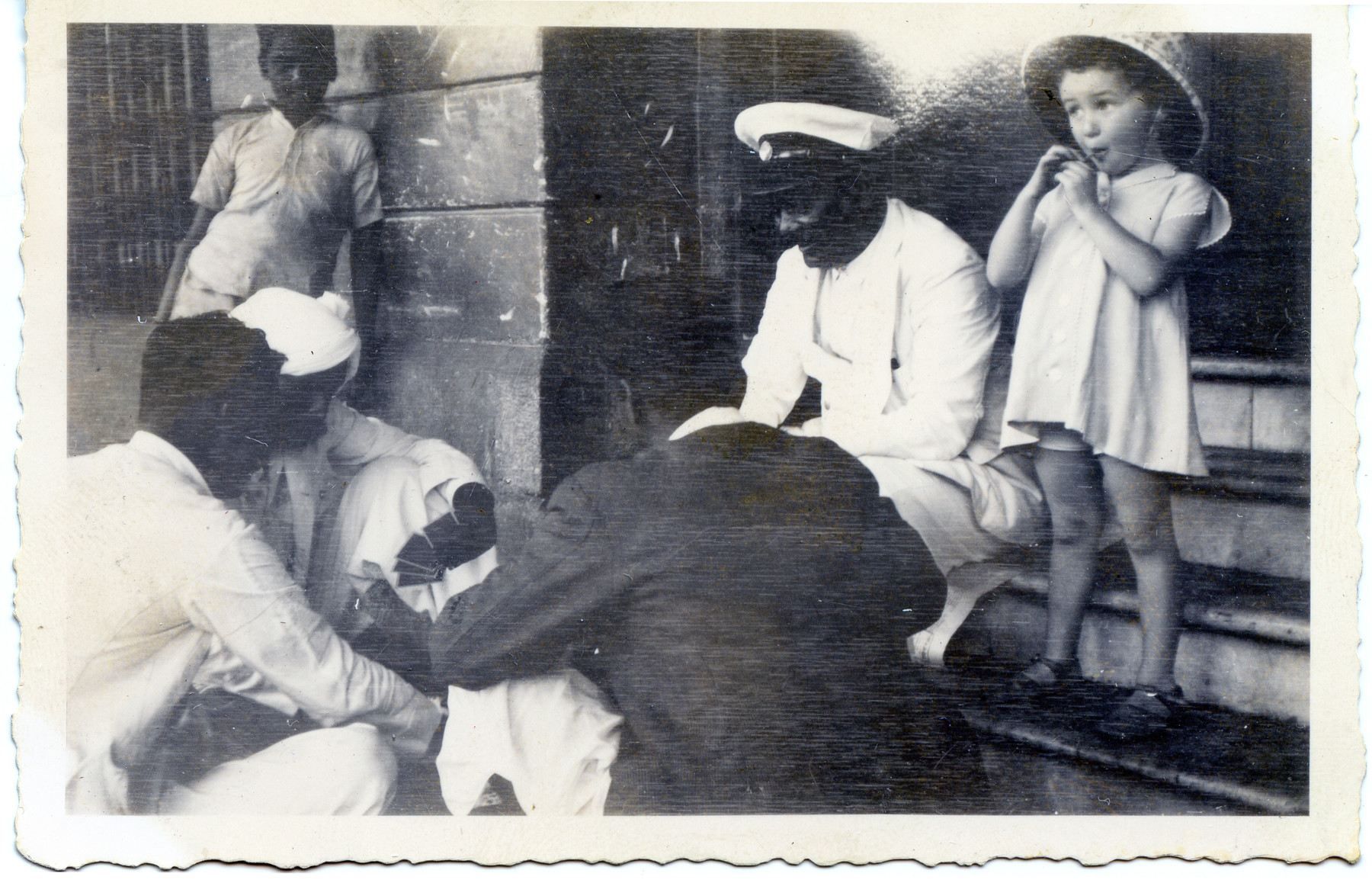 Joanna Klein watches a group of Indian men play cards while stopping in Bombay en route to America.