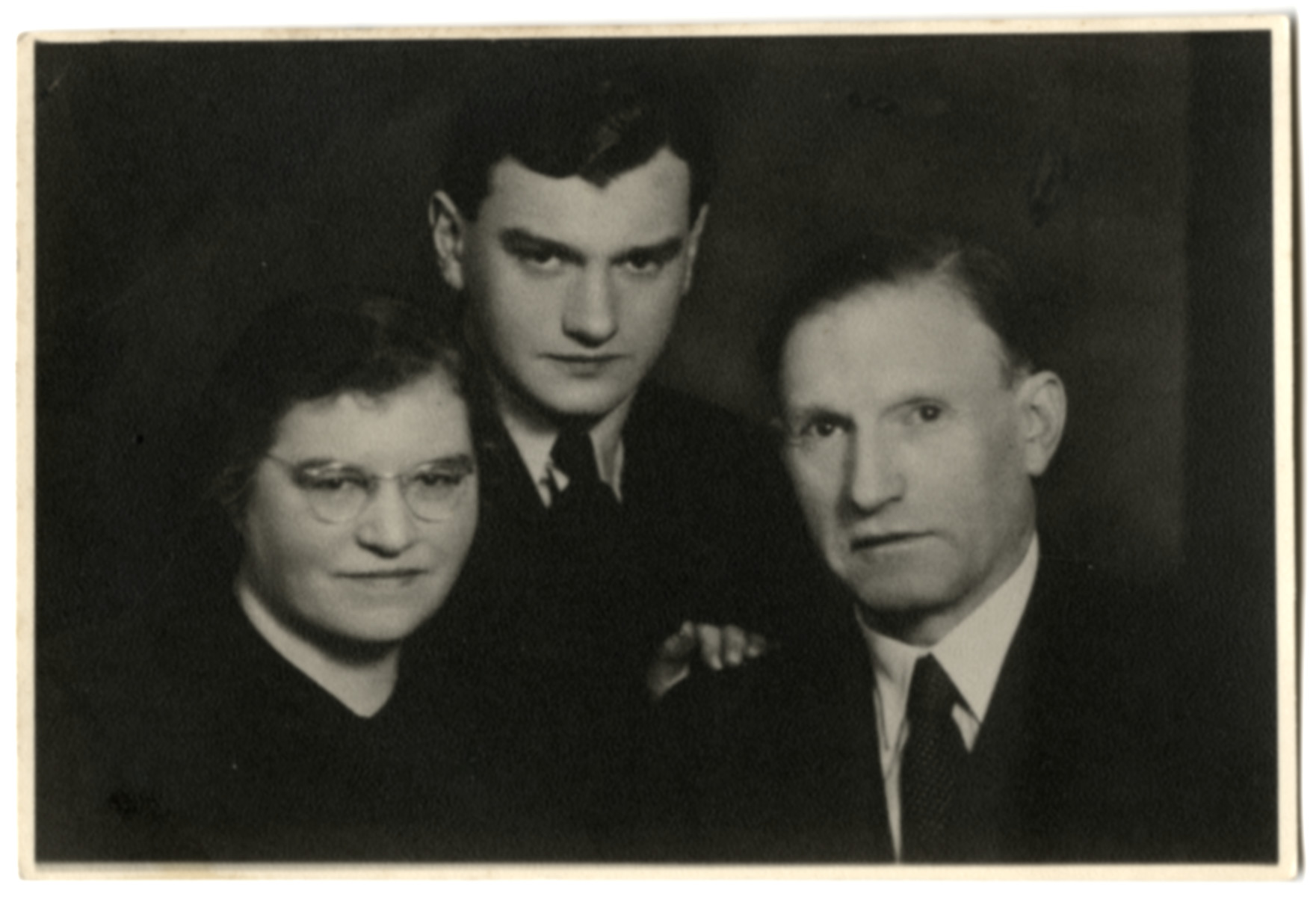 Studio portrait of the Elkes family in prewar Kaunas.  From left to right are Miriam, Joel and Dr. Elkhanan Elkes.