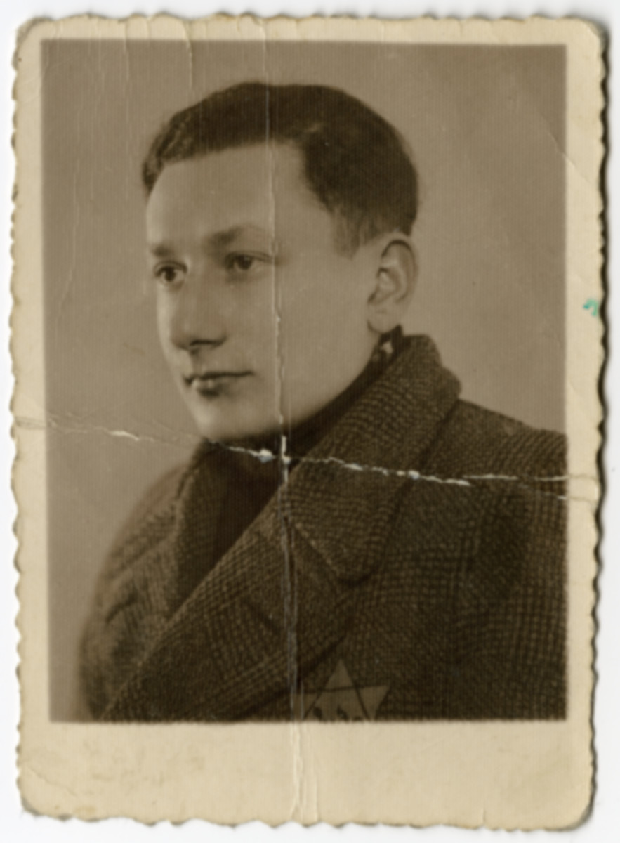 Studio portrait of Moshe Szeps (a friend of the donor) wearing a Jewish star in the Dabrowa ghetto.