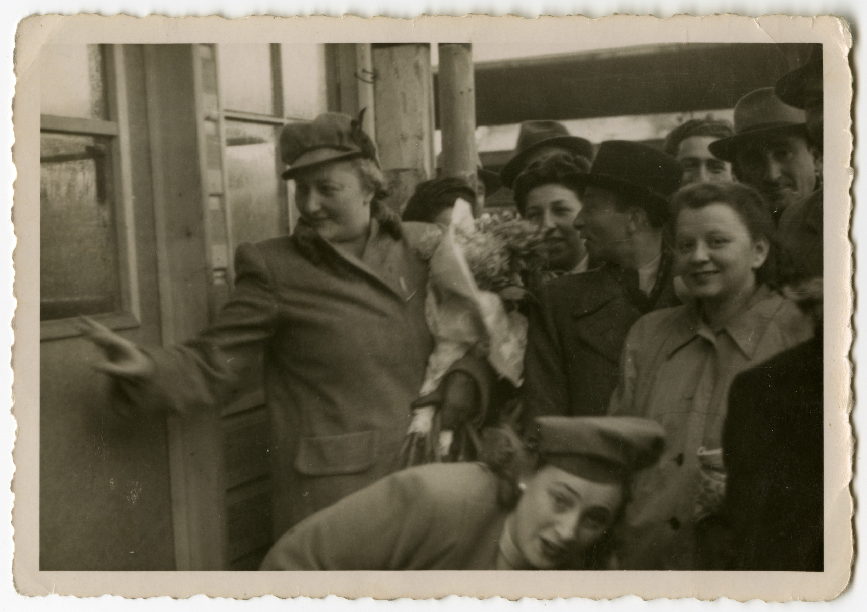 Rozka (sister of the donor) prepares to leave for Palestine as friends gather at the Weiden train station to say good-bye,  On the bottom of the photo is her sister Bluma.