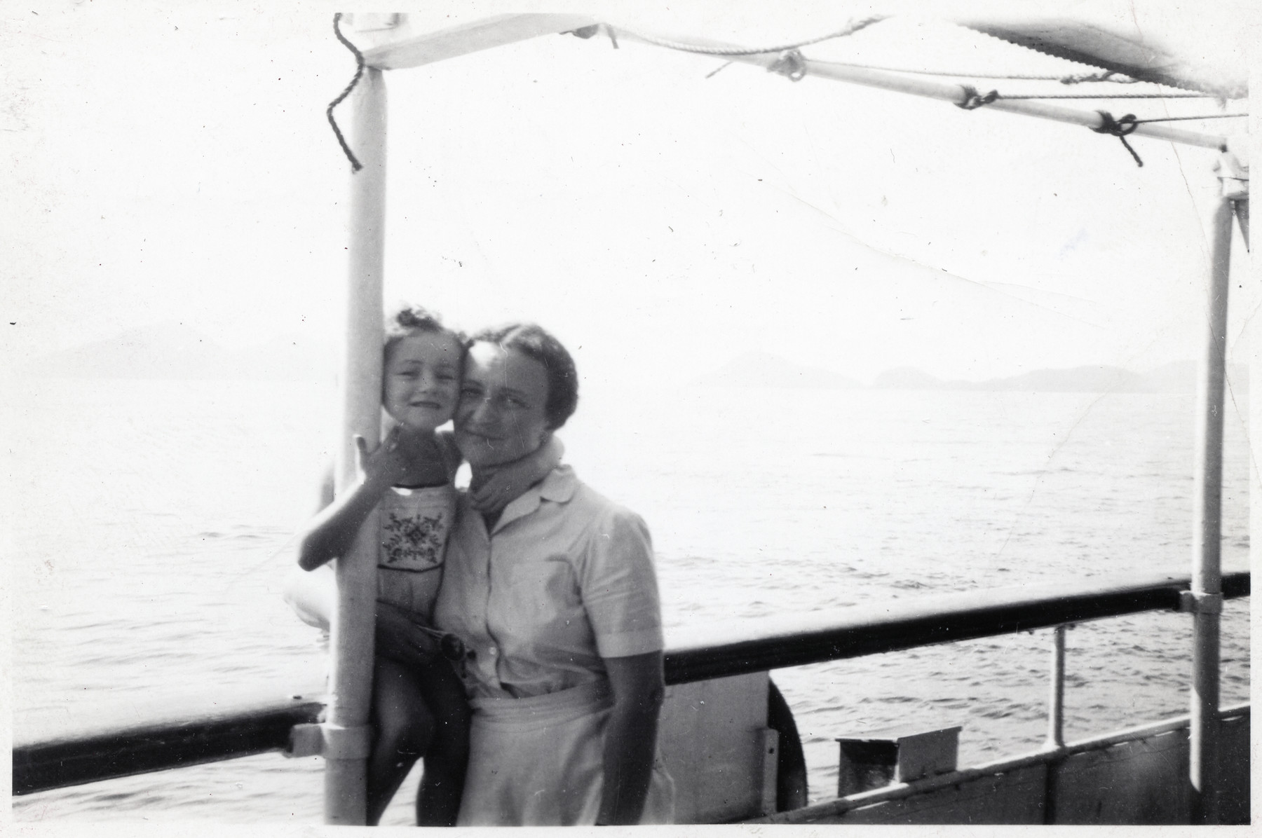 Joasia and Nadzieja Klein pose on the deck of the USS President Harrison while en route to the United States.