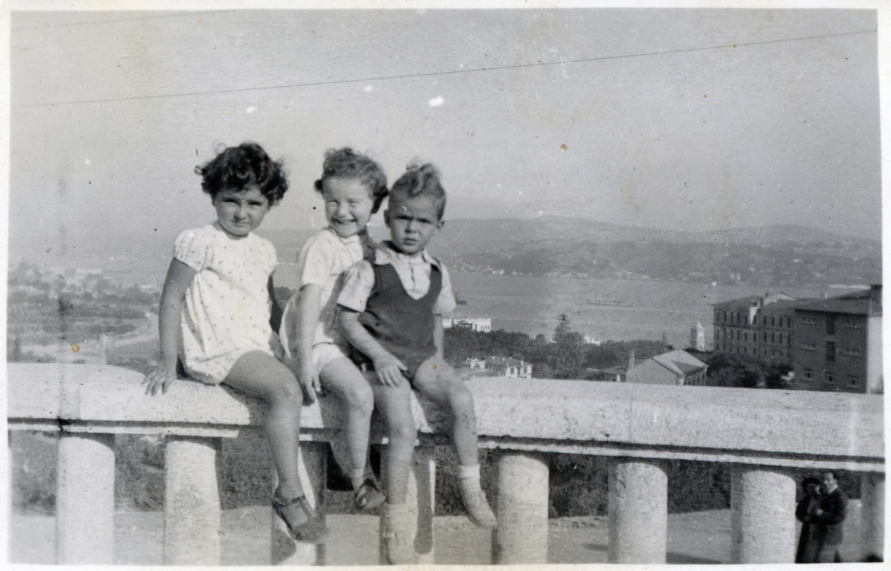 Joasia Klein poses on a bridge in Istanbul, Turkey with two other young children.