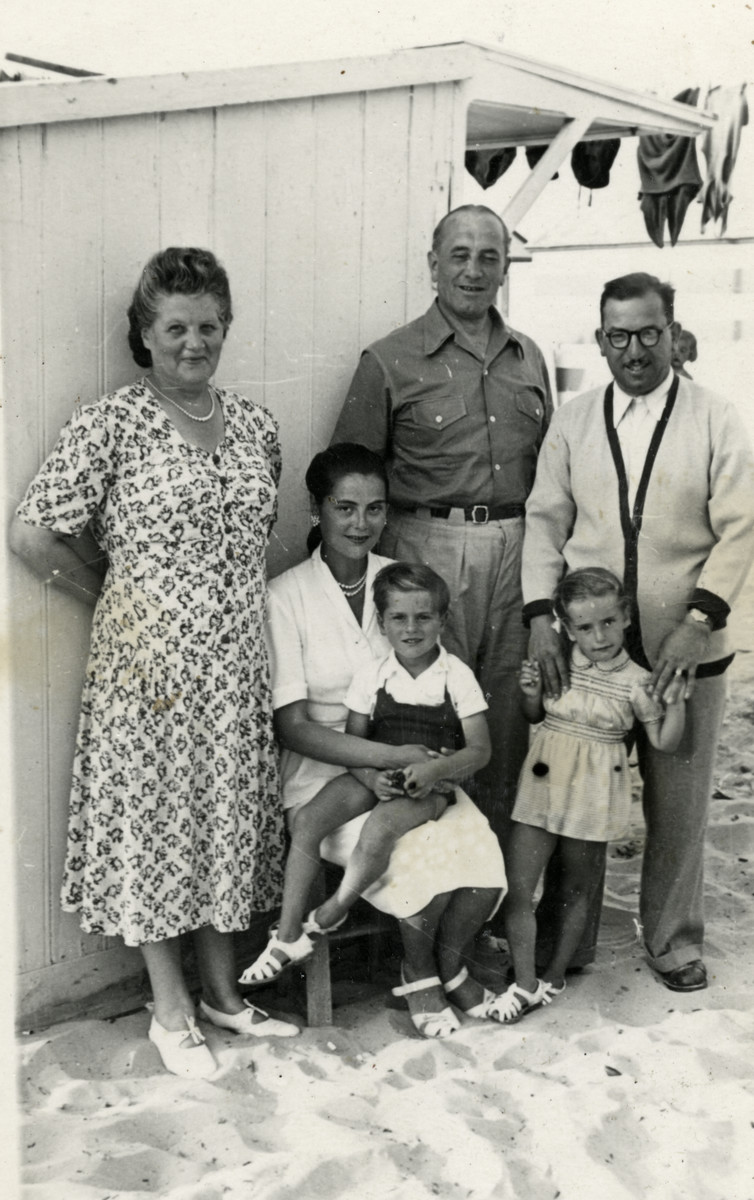 The Cassorla family poses near a cabin on a beach.   From left to right: donor's grandmother, Fanny Reicher, Jose Cassorla, donor's grandfather, Danielle Cassorla and Rabbi Moise Cassorla.