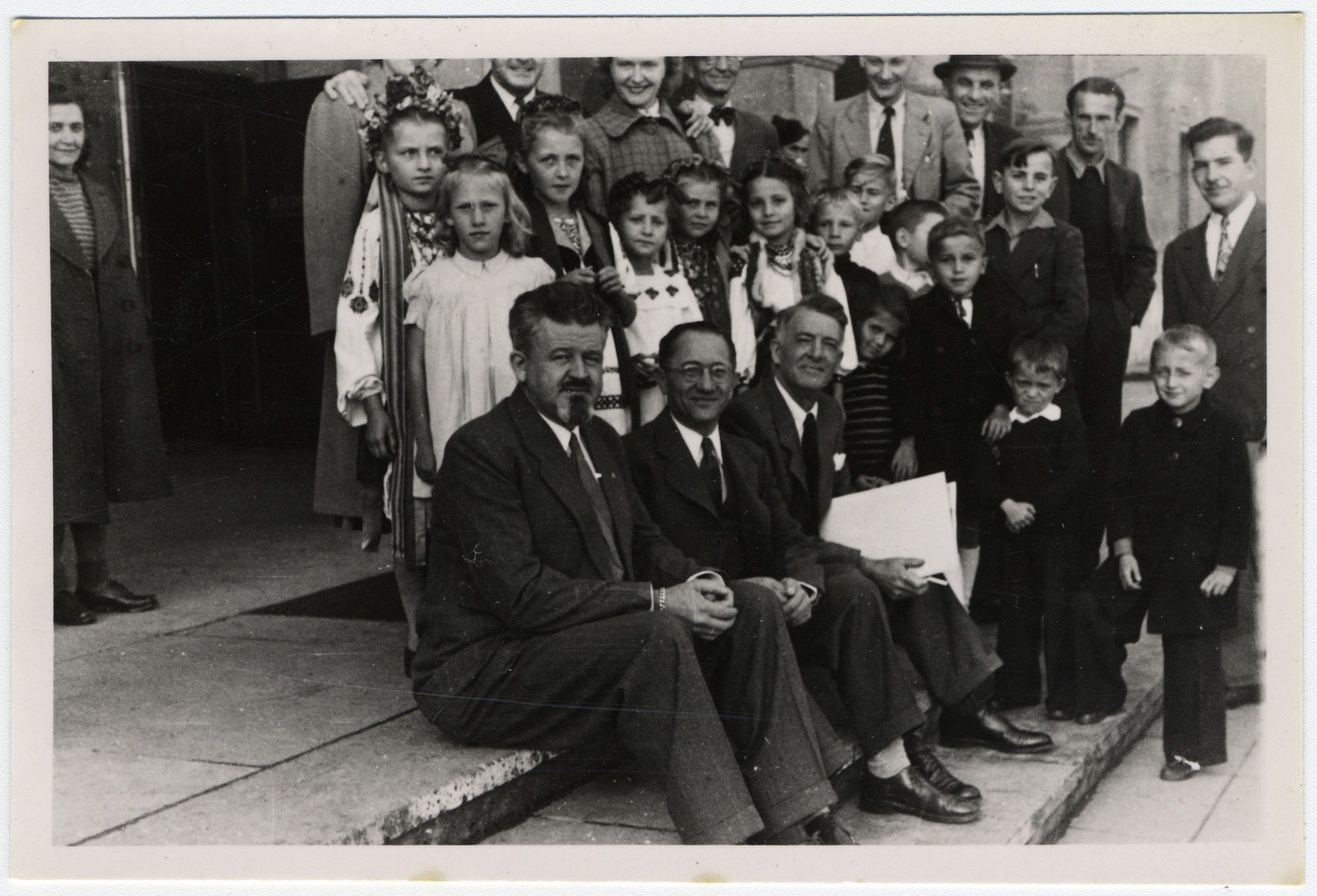 Group portrait of children and adults awaiting repatriation from Berlin to the American Zone.
