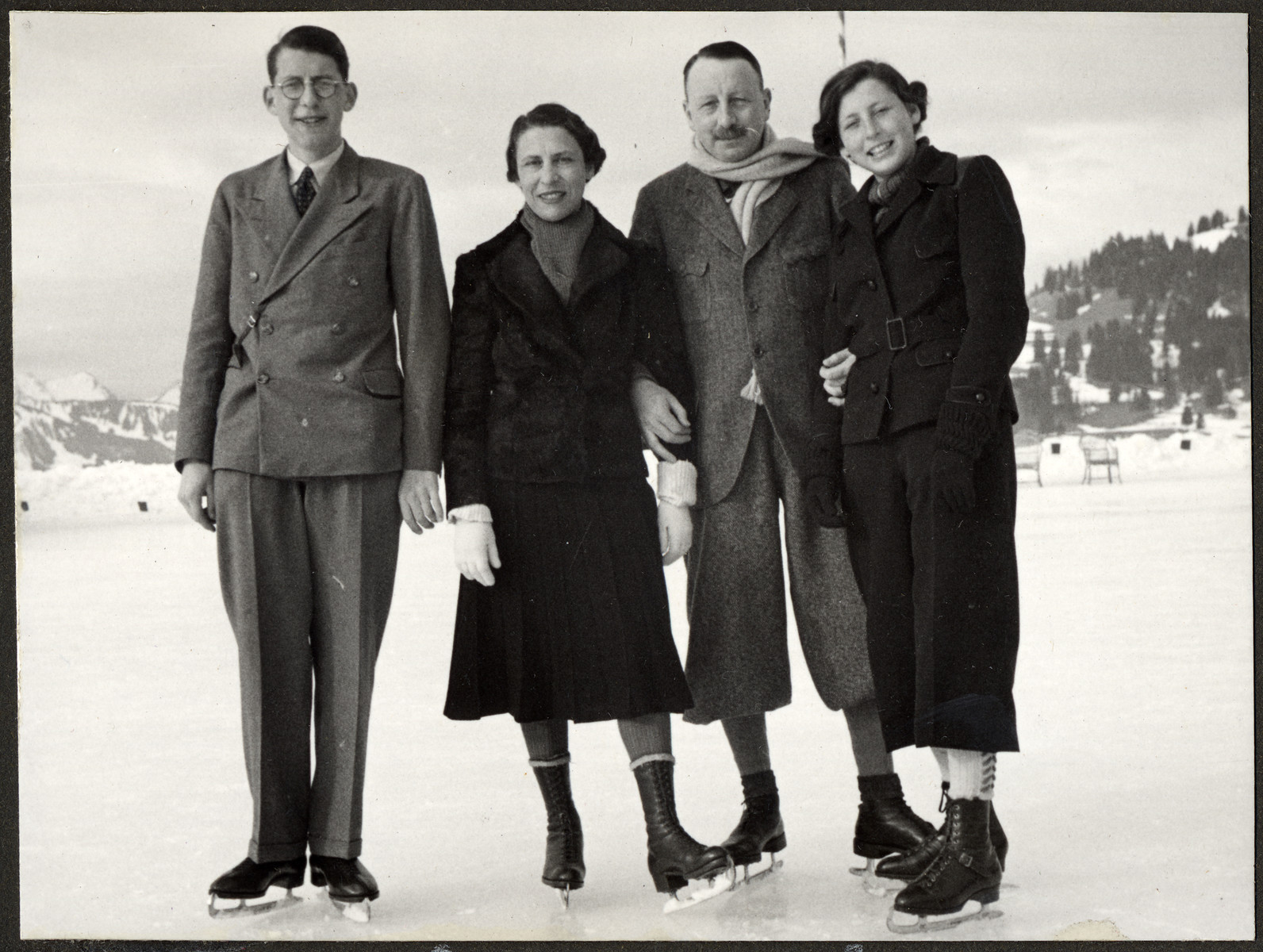 The Bing family goes ice skating outdoors.  Pictured from left to right are John Bing, Erna Stern Bing, Ernst Bing, and Annelise Bing.