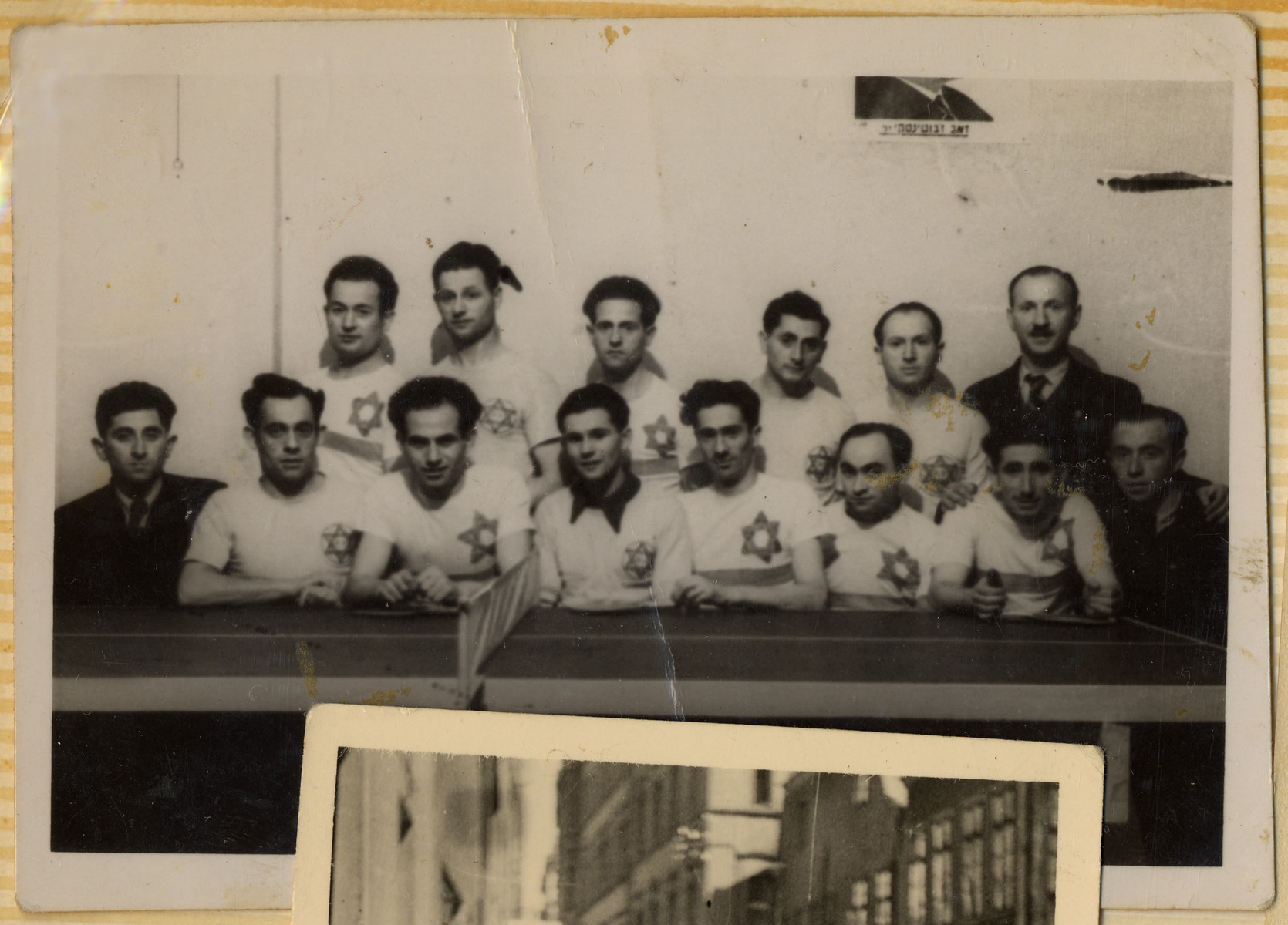 Group portrait of a ping pong team in the Hofgeismar displaced persons camp.