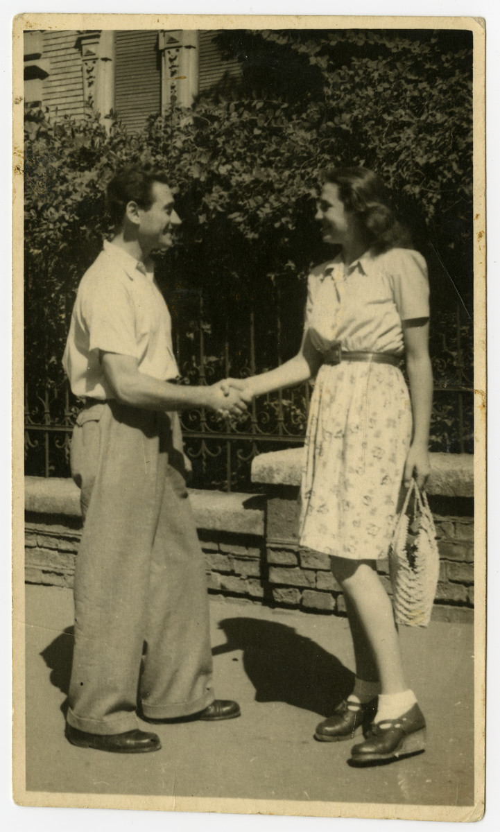 Oscar Kalmar and Edith Weiss Spiegel, both Jews hiding in Budapest, shake hands.