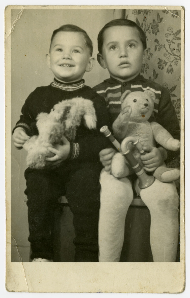 Postwar portrait of two Jewish brothers with their stuffed animals in Komarno, Czechoslovakia.  Pictured are George and Ivan Kalmar.