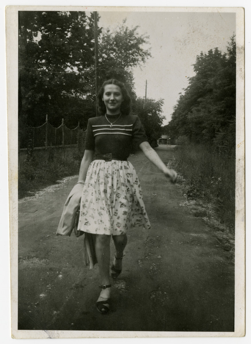 Edith Weiss Spiegel walks down a country road shortly after liberation.