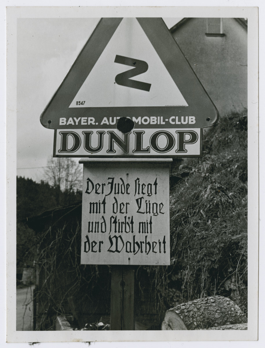 "One photograph from an album of antisemitic signs in Germany.  The sign (in German) reads, ""Der Jude seigt mit der Luege und stirbt mit der Wahrheit.""  [The Jew prevails with the lie and dies with the truth.]"