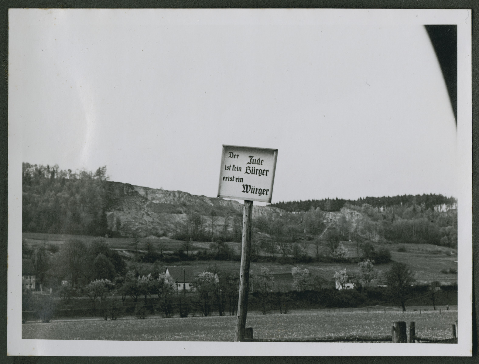 "One photograph from an album of antisemitic signs in Germany.  The sign (in German) reads, ""Der jude ist sein Buerger er ist ein Wuerger.""  [The Jew is for his own people; he is a strangler.]"