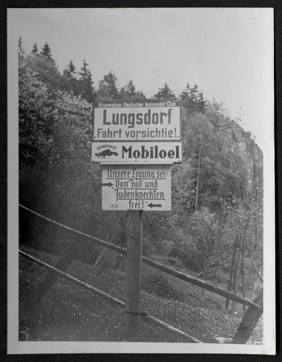 """One photograph from an album of antisemitic signs in Germany.  The sign (in German) reads, """"Unsere Loesung sei von Jud' und Judenknechten frei.""""  [Our solution is freedom from Jews and Jewish knaves.]"""