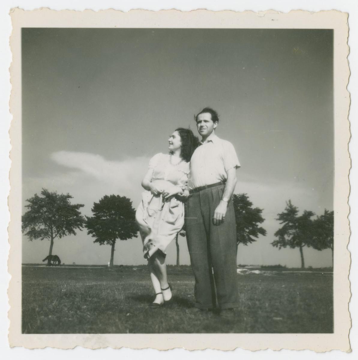 Ada and Rafael Abrahamer stand in a field in postwar Austria.