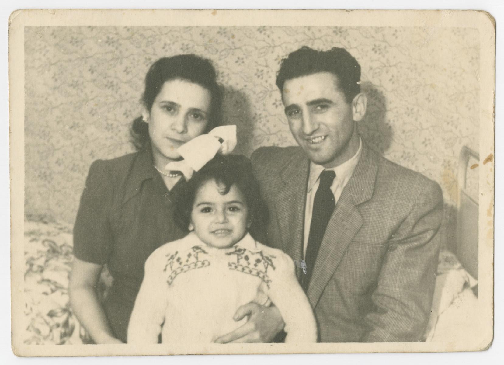 Family portrait of Malka, Abram and Ellen Zinger in the Bergen-Belsen displaced persons camp.
